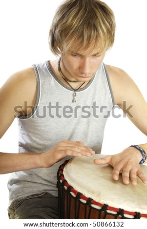 Guy's playing tomtom - stock photo