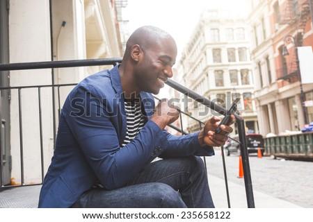 Guy Using Smart Phone - stock photo