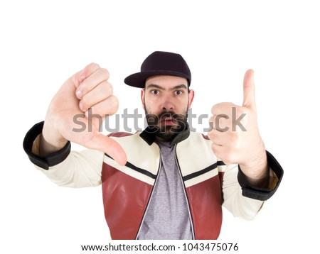 Guy with cap and jacket making funny expressions