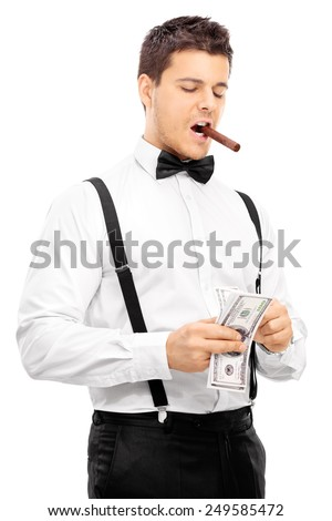 Guy with cigar in his mouth counting money isolated on white background - stock photo