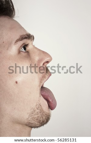 guy with mouth wide opened showin tongue - stock photo
