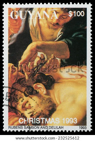 """GUYANA - CIRCA 1993: A stamp printed in Guyana shows Painting """"Christmas Samson and Delilah"""" by Ruben, with the same inscription, from the series """"Christmas 1993"""", circa 1993 - stock photo"""