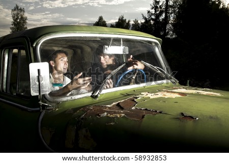 guys are talking in the old car - stock photo