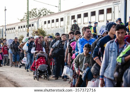 GYEKENYES- OCTOBER 5 : War refugees at the Gyekenyes Zakany Railway Station on 5 October 2015 in Gyekenyes, Hungary. Refugees are arriving constantly to Hungary on the way to Germany. - stock photo