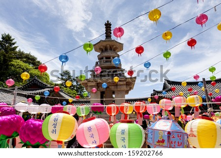 GYEONGIU kOREA MAY 17: People are visiting the Bulguksa Temple with hanging lanterns for celebrating the Buddha's birthday on May 17 2013 in Gyeongiu, Korea.  - stock photo