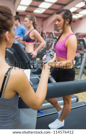 Gym assessment with stopwatch in the gym - stock photo