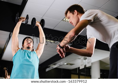 Gym buddies working out timing exercise - stock photo