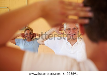 Gym class working out with fitness coach - stock photo