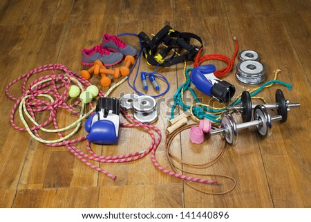 gym equipment on the wooden floor - stock photo