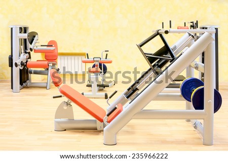 Gym. Fitness club weight training equipment  - stock photo