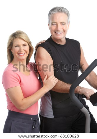 Gym & Fitness. Smiling elderly couple working out. Isolated over white background - stock photo