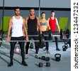 gym group with weight lifting bar workout in exercise - stock photo