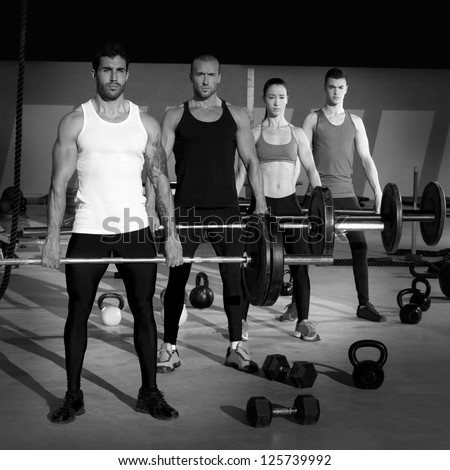 gym group with weight lifting bar workout in fitness