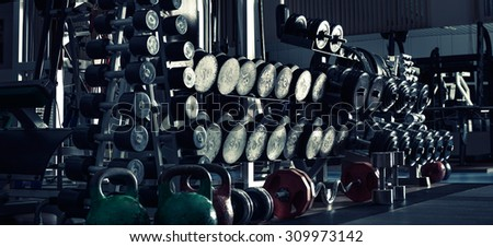 gym indoor interior with dumbbells;  horizontal panorama photo, blue tone - stock photo