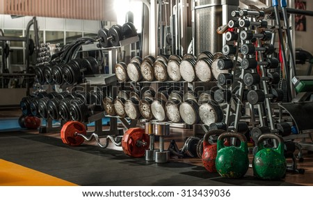 gym indoor interior with dumbbells; horizontal  photo - stock photo