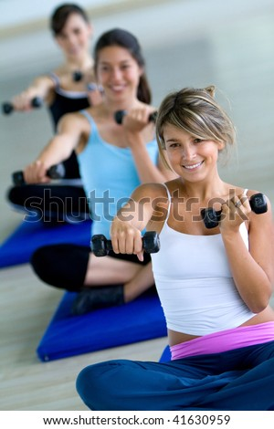 Gym people at an aerobics class with free weights