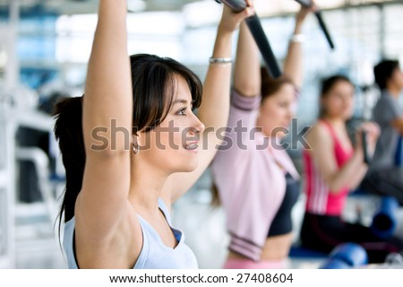 Gym people exercising on weight machines