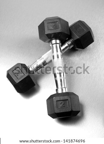 Gym sporting equipment on metalic background - stock photo