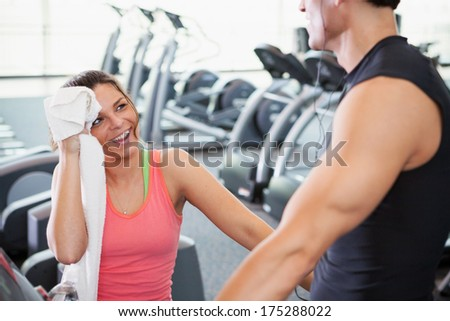 Gym: Sweaty Woman Towels Off After Jogging - stock photo
