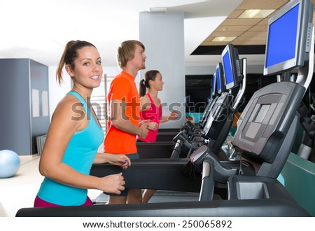 Gym treadmill group running indoor women and blond man - stock photo