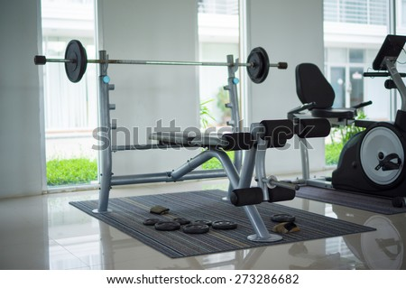 Gym with power dumbell lifting equipment - stock photo