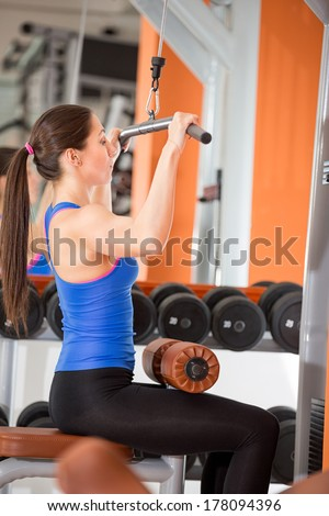 Gym woman on weightlifting training
