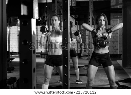 Gym women with barbell and kettlebell workout exercise - stock photo