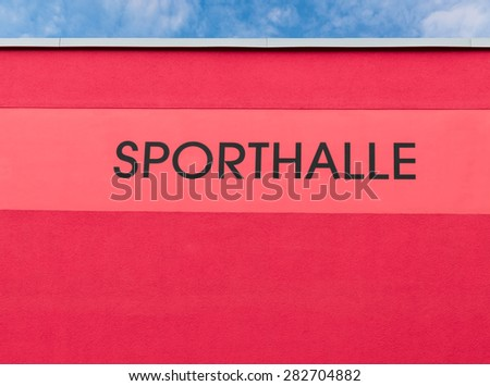 Gymnasium facade background red - stock photo
