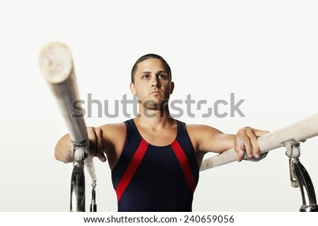 Gymnast by Parallel Bars - stock photo