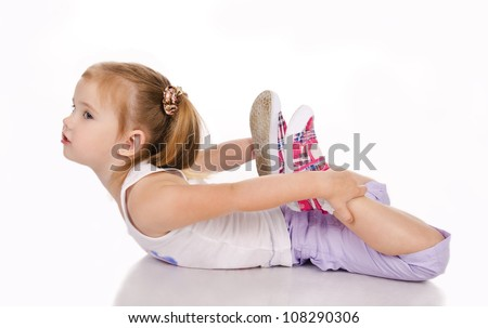 Gymnast cute little girl isolated on a white - stock photo