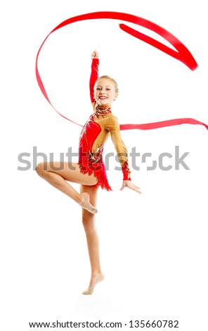 Gymnast with ribbon - stock photo