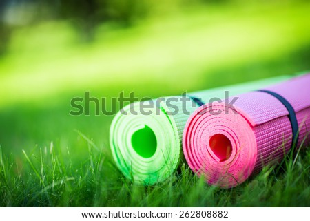 Gymnastic mats on the grass - stock photo