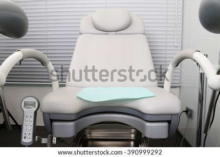 Gynecological chair in a medical office  - stock photo