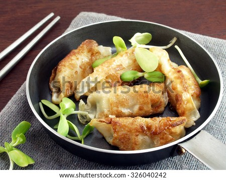gyoza Japanese food in pan, fried dumplings with vegetables, Eating culture of Asia - stock photo