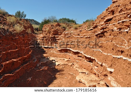 Gypsum layers in wash in Caprock Canyons State Park, Texas - stock photo