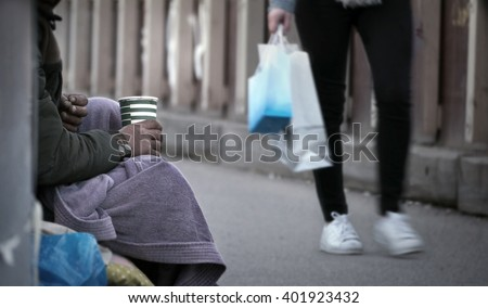 Gypsy asks for charity  - stock photo