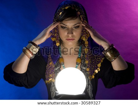 Gypsy fortune-teller uses a crystal ball to foretell the future