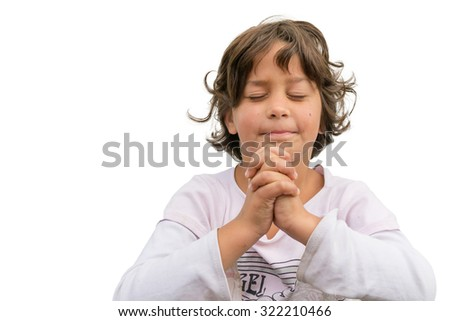 Gypsy spiritual child holds folded hand pray and trust in god with innocence - stock photo