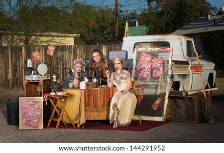 Gypsy travellers with fortune telling stand outside - stock photo