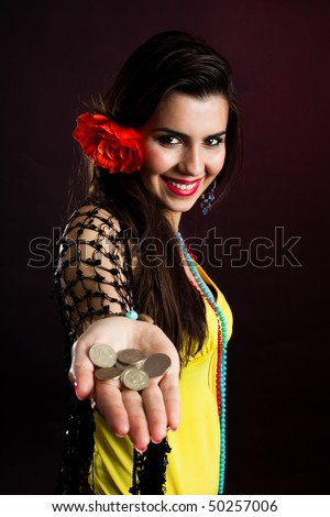 gypsy woman offer money drawing out palm with coins - stock photo