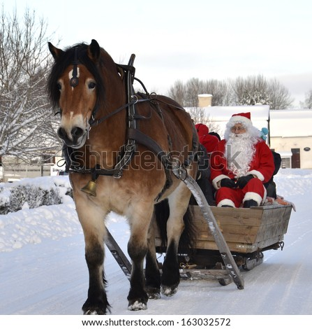 GYSINGE, SWEDEN - DECEMBER 9: Unidentified Santa Claus goes to Christmas market with a horse Official name is Gysinge julmarknad and organization are vi i Gysinge on December 9, 2012 in Gysinge Sweden - stock photo