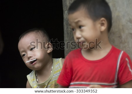 HA GAING, VIETNAM - SEPTEMBER 18, 2015: Vietnamese, Children thrill visitors. province Ha Sang. north of Vietnam.