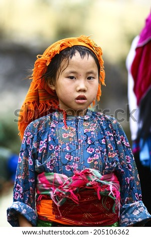 HA GIANG, VIET NAM - MAY 9, 2010: Unidentified traditionally dressed girl of Hmong ethnic minority tribe in Viet Nam. Hmong people are known for their indigo-dyed costumes and ornate silver jewellery. - stock photo