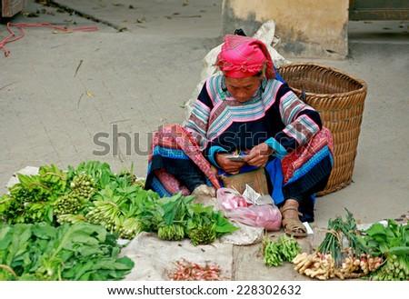 HA GIANG, VIETNAM - October 18, 2014: Woman in ethnic Hmong fair in Ha Giang, Vietnam. Ha Giang is home to mostly Hmong live. - stock photo