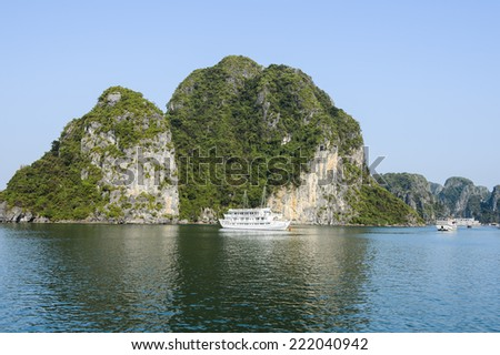HA LONG BAY, VIETNAM - SEP 23, 2014: Small touristic ship in the Halong bay, Vietnam. UNESCO World Heritage