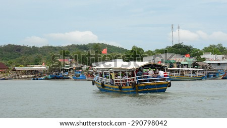 HA LONG CITY, VIETNAM - JUN 23, 2015. Tourist boats near the port of the Ha Long city where many touristic boats start jorneys over the Ha Long bay which is UNESCO World heritage.