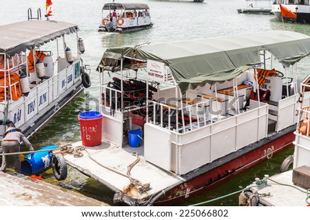 HA LONG CITY, VIETNAM - SEP 23, 2014: Boat at the port of the Halong city where many touristic boat start jorneys over the Halong bay which is UNESCO World heritage