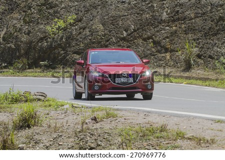 Ha Noi, Viet Nam - April 13, 2015: Mazda3 all new (2015) car running on the moutain road in Vietnam - stock photo