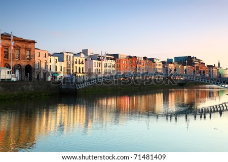 Ha'penny Bridge is pedestrian bridge built in 1816 over River Liffey in Dublin, Ireland. - stock photo