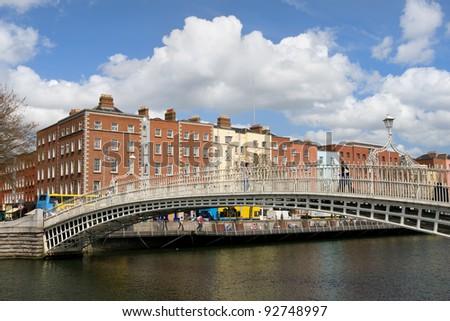 Ha'penny Bridge on the river Liffey in the city of Dublin, Ireland. - stock photo